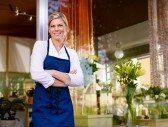 10684102-portrait-of-beautiful-caucasian-girl-self-employed-in-flower-shop-smiling-and-looking-at-camera-hori